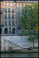 Quay and riverfront buildings on banks of the Seine. Paris, France