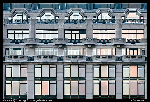 Glass windows of the Samaritaine reflecting colors of sunset. Paris, France (color)