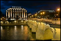 Pont Neuf and Samaritaine illuminated at night. Paris, France
