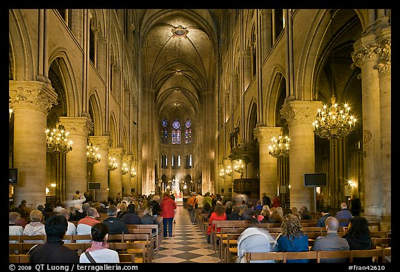 Interior of Notre-Dame de Paris during mass. Paris, France (color)