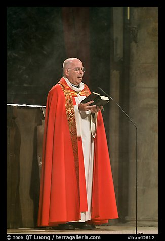 Cardinal of catholic church reading in Notre-Dame. Paris, France (color)