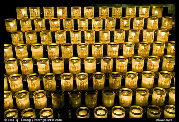 Array of candles, Notre-Dame cathedral. Paris, France (color)
