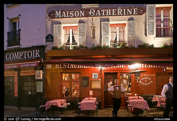 Restaurant and waiter at night, Montmartre. Paris, France (color)
