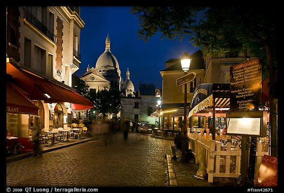 Place du Tertre at night with restaurants and Basilique du Sacre-Coeur, Montmartre. Paris, France (color)