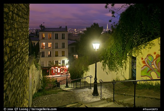 Hillside stairs of butte Montmartre and street lights at sunset. Paris, France (color)