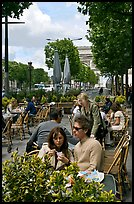 Couple at outdoor cafe on the Champs-Elysees. Paris, France (color)