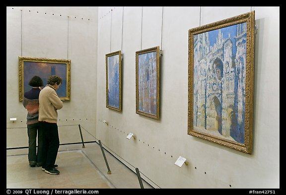 Tourists looking at Monet's Rouen Cathedral, Orsay Museum. Paris, France (color)