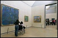 Tourist in wheelchair, Orsay Museum. Paris, France (color)