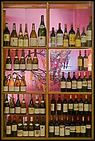Wine bottles in storefront, passage Vivienne. Paris, France (color)