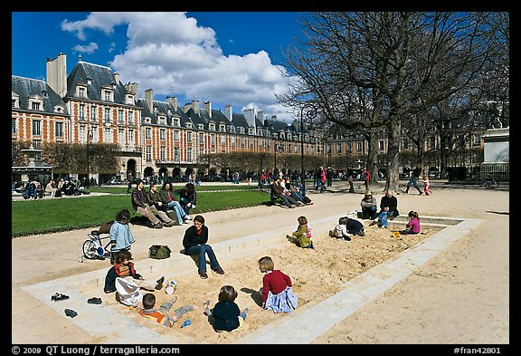 Children playing in sandbox, Place des Vosges. Paris, France (color)