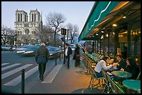 Cafe, street, and Notre Dame at dusk. Quartier Latin, Paris, France (color)