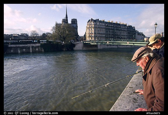 Fishermen on ile Saint Louis, with ile de la Cite in the background. Paris, France (color)