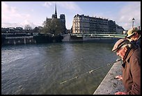 Fishermen on ile Saint Louis, with ile de la Cite in the background. Paris, France