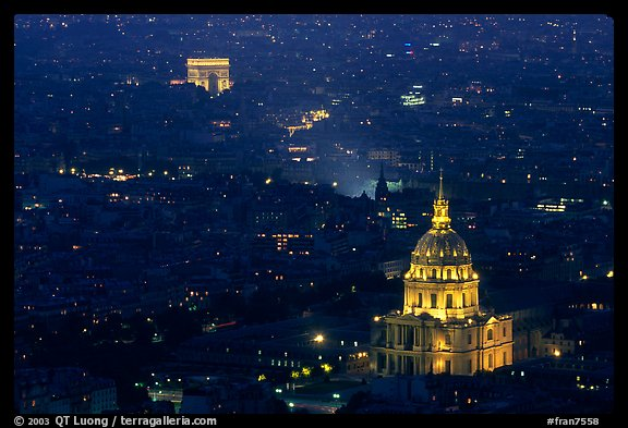 Aerial view of Arc de Triomphe and Invalides by night. Paris, France (color)