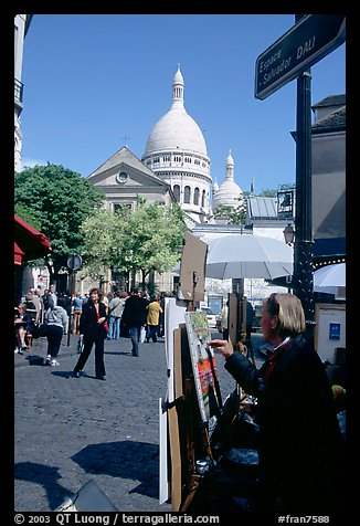 Painter on Place du Tertre, with the Sacre Coeur in the background, Montmartre. Paris, France (color)