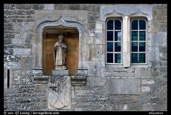 Statue and window, Fontenay Abbey. Burgundy, France (color)