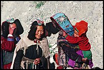 Elderly women with turquoise-covered head adornments, Zanskar, Jammu and Kashmir. India
