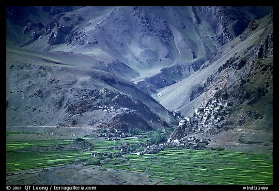 Cultivated fields, village, gompa, and barren mountains, Zanskar, Jammu and Kashmir. India (color)