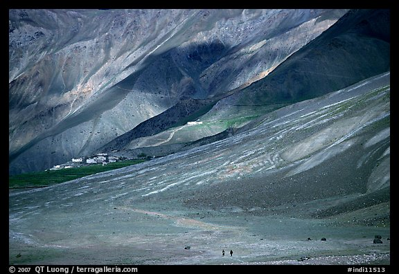 Barren hills with figures walking towards Karsha monastery, Zanskar, Jammu and Kashmir. India