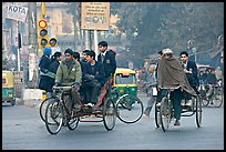 Cycle-rickshaws carrying uniformed schoolchildren. New Delhi, India ( color)