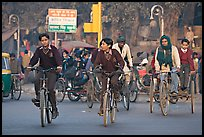 Children riding bikes in rickshaws on way to school. New Delhi, India ( color)