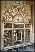 Marble door carved from a single slab with justice symbols, Diwan-i-Khas, Red Fort. New Delhi, India (color)