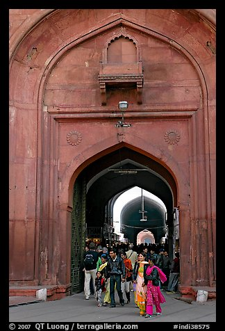 People walking out of the Covered Bazar, Red Fort. New Delhi, India (color)