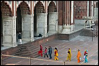 Women in colorful sari walking towards prayer hall, Jama Masjid. New Delhi, India
