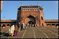 Muslim worshippers climbing  Jama Masjid South Gate. New Delhi, India ( color)