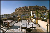 Rooftop restaurant with view on Mehrangarh Fort. Jodhpur, Rajasthan, India (color)