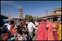 Sadar Market, with women in colorful sari and clock tower. Jodhpur, Rajasthan, India (color)