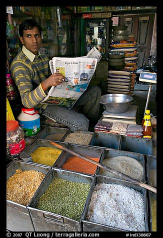 Man with newspaper selling grains, Sardar Market. Jodhpur, Rajasthan, India (color)
