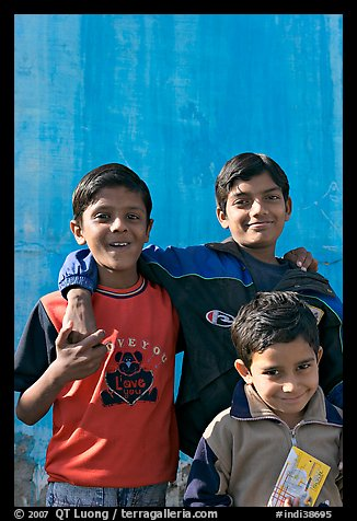 Young boys in front of blue wall. Jodhpur, Rajasthan, India (color)