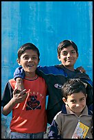 Young boys in front of blue wall. Jodhpur, Rajasthan, India ( color)