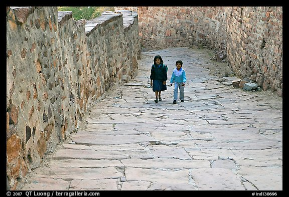 Children walking on the stone ramp leading to the fort. Jodhpur, Rajasthan, India (color)
