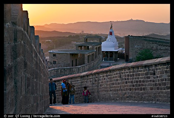 Family atop the walls of Mehrangarh Fort at sunset, Mehrangarh Fort. Jodhpur, Rajasthan, India (color)