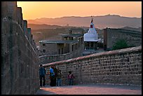 Family atop the walls of Mehrangarh Fort at sunset, Mehrangarh Fort. Jodhpur, Rajasthan, India