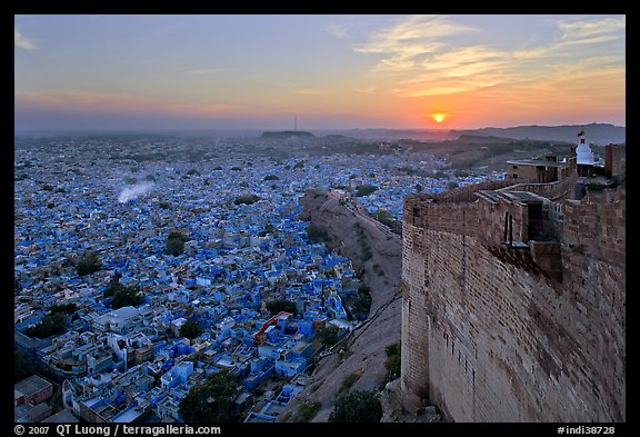 Mehrangarh Fort walls, blue houses, and setting sun. Jodhpur, Rajasthan, India (color)
