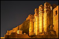 Towers and 36m high walls of Mehrangarh Fort by night. Jodhpur, Rajasthan, India (color)