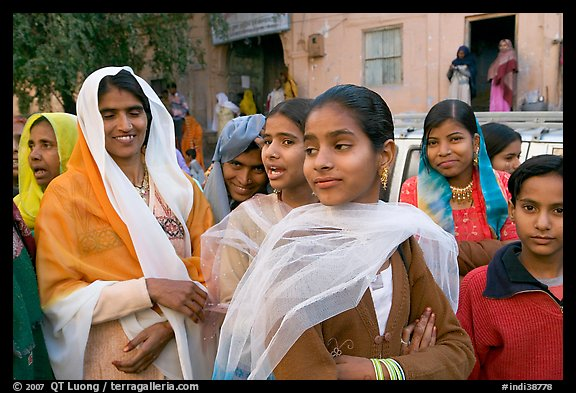 Women standing in the street during a wedding. Jodhpur, Rajasthan, India (color)