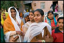Women standing in the street during a wedding. Jodhpur, Rajasthan, India