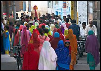 Women in colorful sari in a narrow street during wedding. Jodhpur, Rajasthan, India