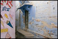 Whitewashed walls with indigo tint and ice-cream depictions. Jodhpur, Rajasthan, India ( color)