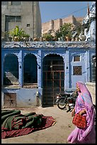 Woman in sari, blue house, and fort in the distance. Jodhpur, Rajasthan, India ( color)