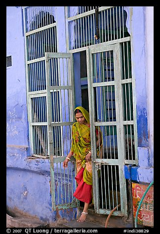 Woman stepping out of door. Jodhpur, Rajasthan, India (color)