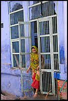 Woman stepping out of door. Jodhpur, Rajasthan, India ( color)