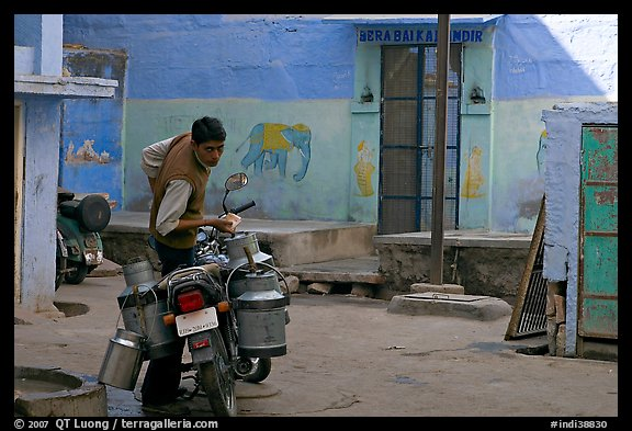 Man with milk delivery motorbike. Jodhpur, Rajasthan, India (color)