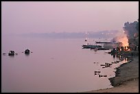 Ganges River at sunset with cremation fire. Varanasi, Uttar Pradesh, India