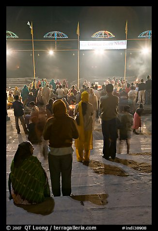 Worshipers during evening arti ceremony at Ganga Seva Nidhi. Varanasi, Uttar Pradesh, India (color)