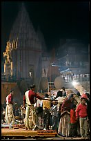 Brahmans giving blessings after evening arti ceremony. Varanasi, Uttar Pradesh, India (color)